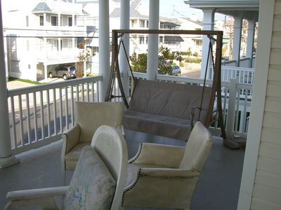 Huge 2nd FL porch. New white wicker swing replaced this swing. tons of Furniture