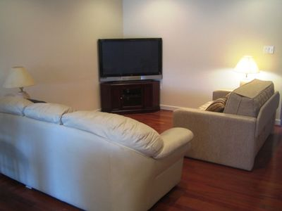 "Living room portion of the open area with 50"" Plasma HDTV Cable channels and DVD"