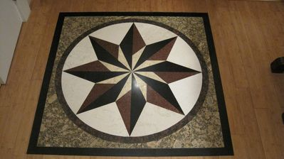 A marble compass rose greets you at the front door w sky lights...