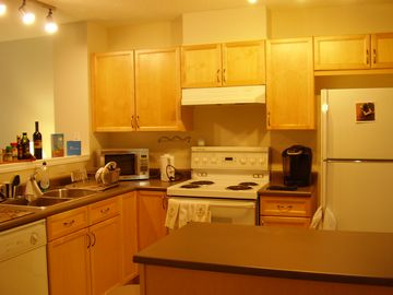 Kitchen with stove, microwave, dishwasher, fridge, and even a coffee machine!!