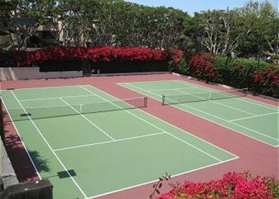 Tennis courts surrounded by flowers