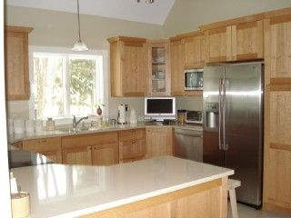 Bright & airy kitchen with skylights and breakfast bar. Fully equipped.