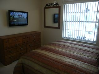 Indian Ridge house photo - Queen Bedroom with 32 inch Flat Panel TV and View of Pool