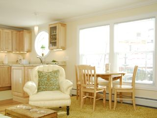 Portland condo photo - Promenade Place-Living Room/Dining Area (Model)