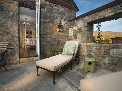 Secluded terrace with chaise lounges and a barn view