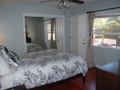 Bedroom with ceiling fan and large closet