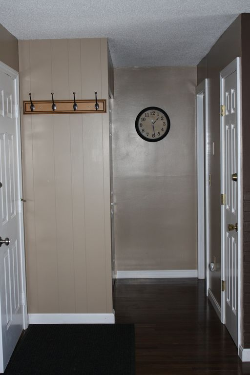 Entrance to condo and hallway to bathroom