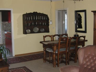 The antique dining table welcomes you and your family for intimate meals
