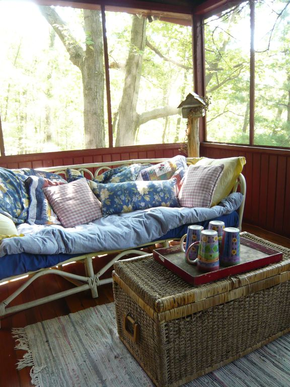 screened porch; comfy settee for afternoon naps!
