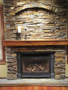 Hand-laid stone gas fireplace for those chilly nights!