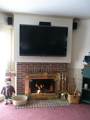 North Conway condo photo - large flat screen TV, and gas fireplace on main level