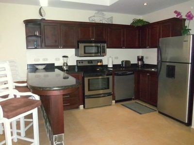 Large, open kitchen w/ stainless steel appliances & granite!