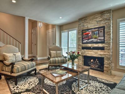 Gather Around the Cozy Stone Fireplace, Flat Screen HD TV!