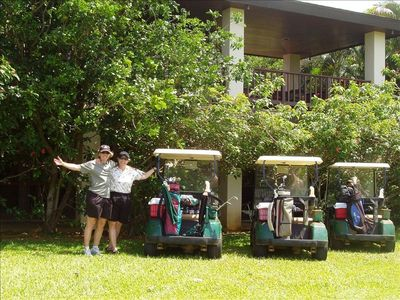 Happy golfers in our backyard with grapefruit tree behind them!