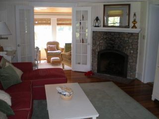 Falmouth house photo - Livingroom and stone fireplace with sunroom entry