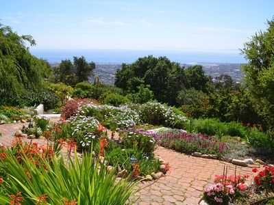 view of the garden and ocean