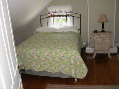 Second flr bedroom, full and twin bed and air conditioner.