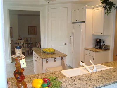 Fully Equipped Kitchen with Granite Counters, Breakfast Nook and Adjacent Dining