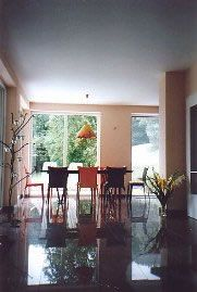 Living/ dining room with granite floor and window