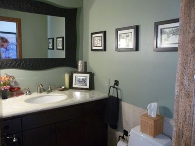 Lovely powder room just off the dining area