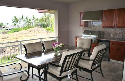 Large upper floor lanai with outdoor kitchen and BBQ.