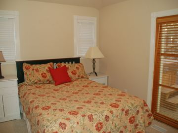 Downstairs bedroom 1, with queen. French doors lead to back patio and hot tub.