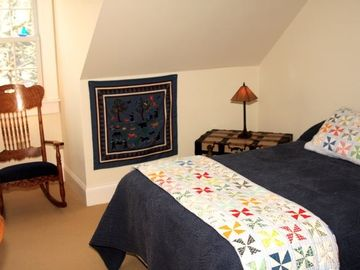 Second floor bedroom with double bed.