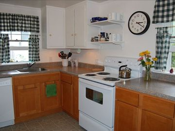 New cabinets, counter top, appliances, and plenty of room-a cook's delight.