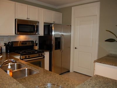Fully Equipped Kitchen along with a stacked washer/dryer-call Kelli 800-933-6068