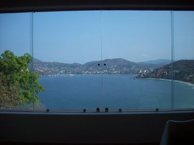 view of bay from livingroom. all windows open to let in ocean breezes & sounds