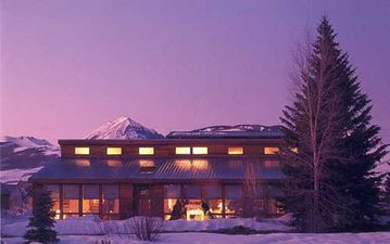 Crested Butte house rental - House view in winter sunset!
