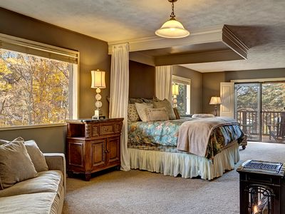 Master Suite with French doors to Balcony with seating overlooking creek