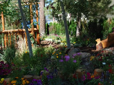 Big Bear Lake house rental - Wild Flower Garden, bridge, and bench. VIew from front porch.