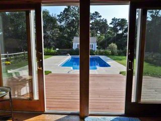 Katama house photo - Sliding Doors From Living Area Open To Sun Deck, Pool Area & Screened Porch
