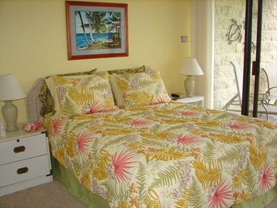Cheerful, roomy master bedroom that opens on to lanai and gorgeous garden view.
