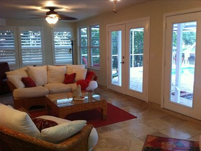 Lanai with 2 sets of french doors that open up to screened in pool.