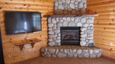 "River rock fireplace and 60"" HDTV with large library of recent movies."