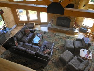 Warren chalet photo - Large open living room with stone fireplace, bar and door to deck.