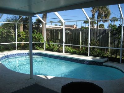 Screened pool area with Hot tub, Weber BBQ & Covered Patio