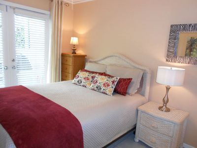 Quiet queen bedroom with french doors to private backyard deck. Comfortable bed.
