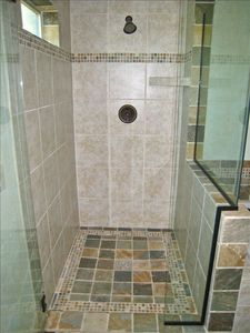 Slate tiled walk in shower with radiant heating in the floor