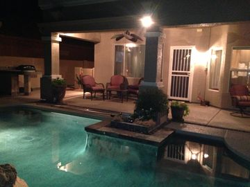 Chandler house rental - Covered patio, grill, fire pit and heated salt water pool.