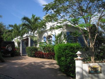 Calypso's entrance has easy access, lush landscaping, and paved parking.
