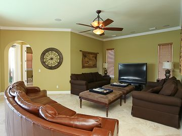 Living room with 55 inch LCD TV and surround sound