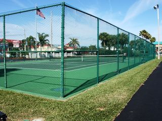 Tennis Courts located at the complex - Cocoa Beach condo vacation rental photo