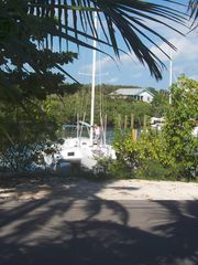 Elbow Cay and Hope Town villa photo - The owner's trimaran sailboat with 30' of space on the other side of the dock.