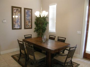 Dining Area Off KItchen w/ French Doors Leading to Side Outside Deck & Gas Grill