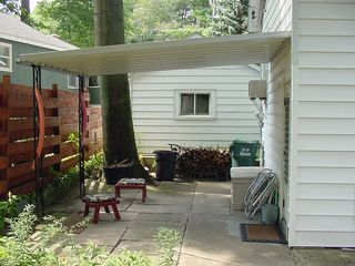 Stay Dry During A Rain With The Awning & Tree Canopy - Muskegon cottage vacation rental photo