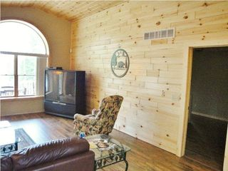Burt Lake cabin photo - Get that warm, cozy up north feeling with pine paneling and Pergo wood floors...