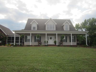 Peaceful country home; enjoy the view spectacular from the porches.